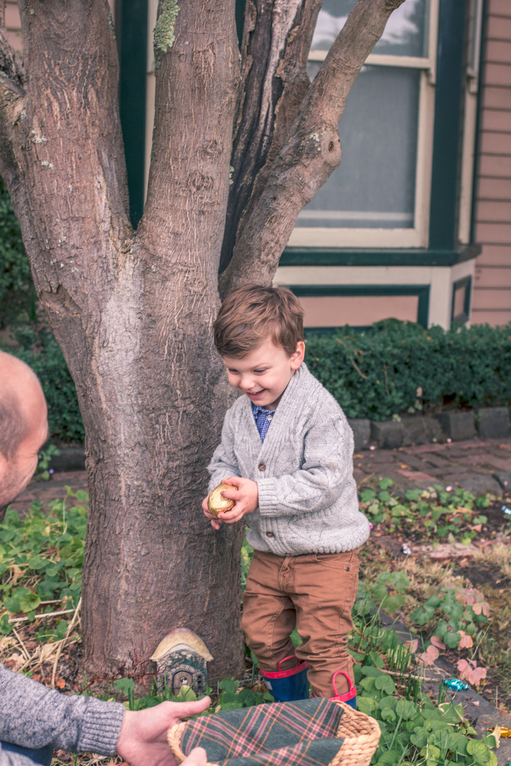 Toddler wearing vintage style boys knitwear for Autumn easter egg hunt