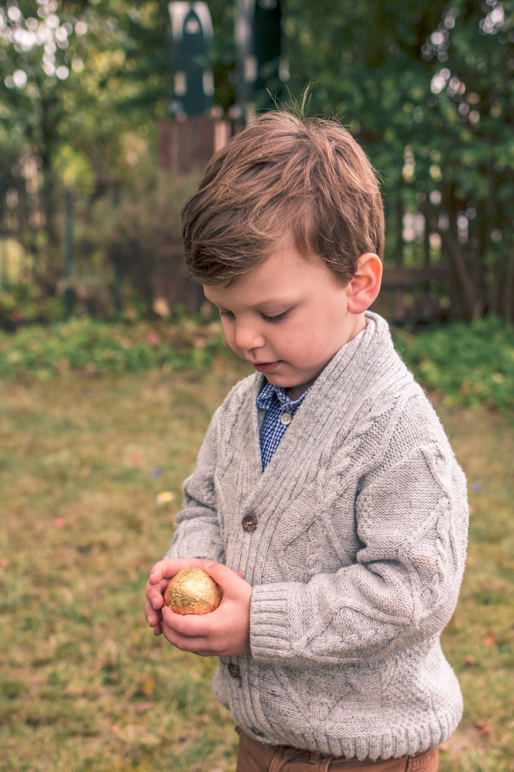 Toddler wearing vintage style knit boys cardigan at Goldfields Girl Autumn Easter Egg Hunt