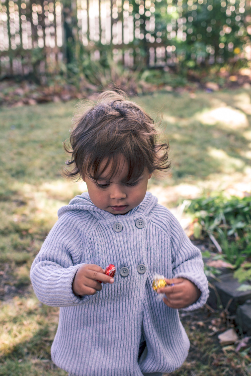 Toddler boy wearing knit cardigan at Autumn Easter Egg Hunt