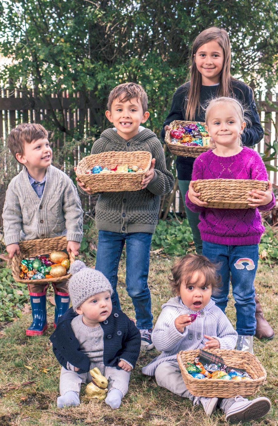 Children holding baskets at Autumn Easter Egg Hunt in Australia