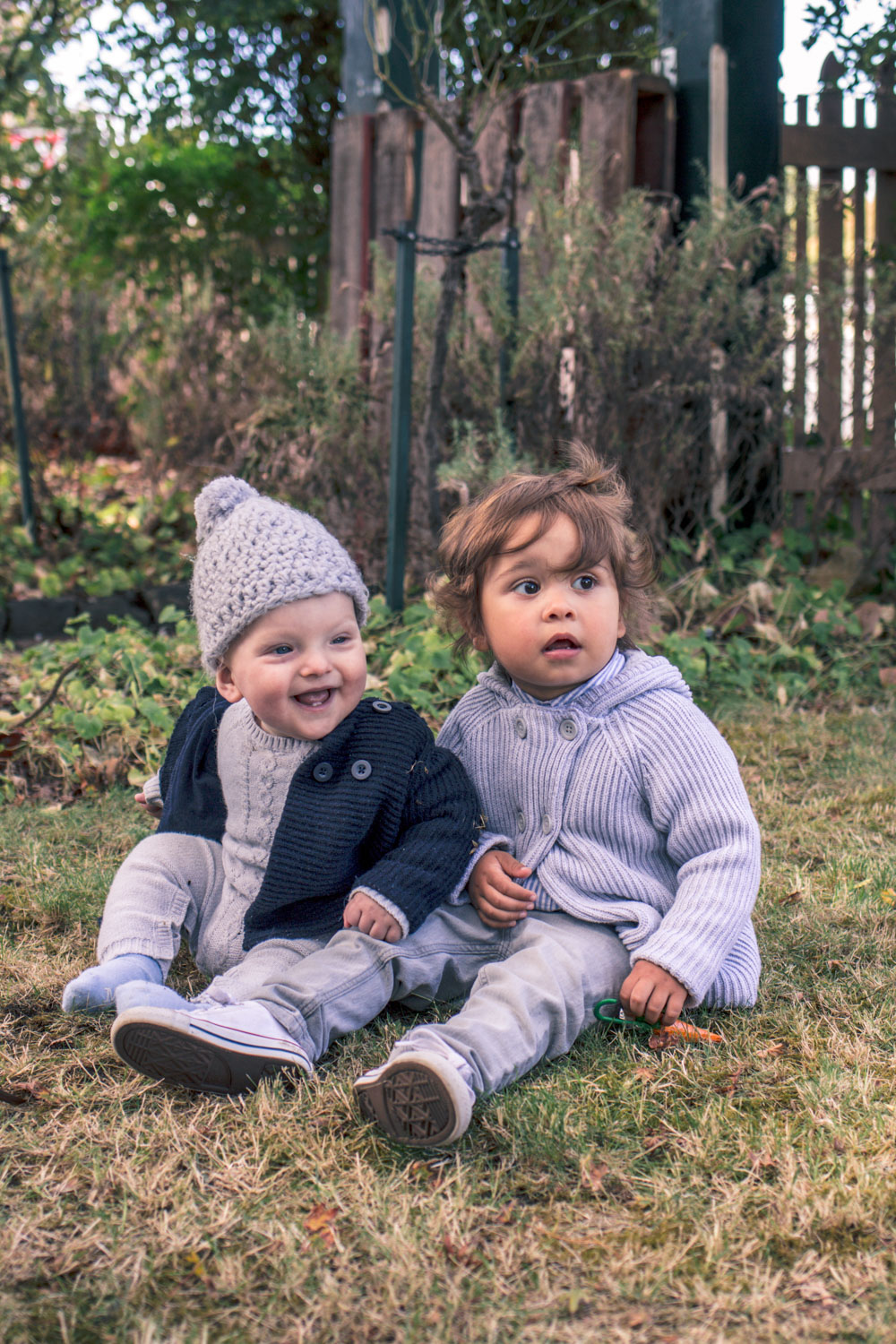 Baby boys wearing Pure Baby knitwear at Autumn Easter Egg Hunt
