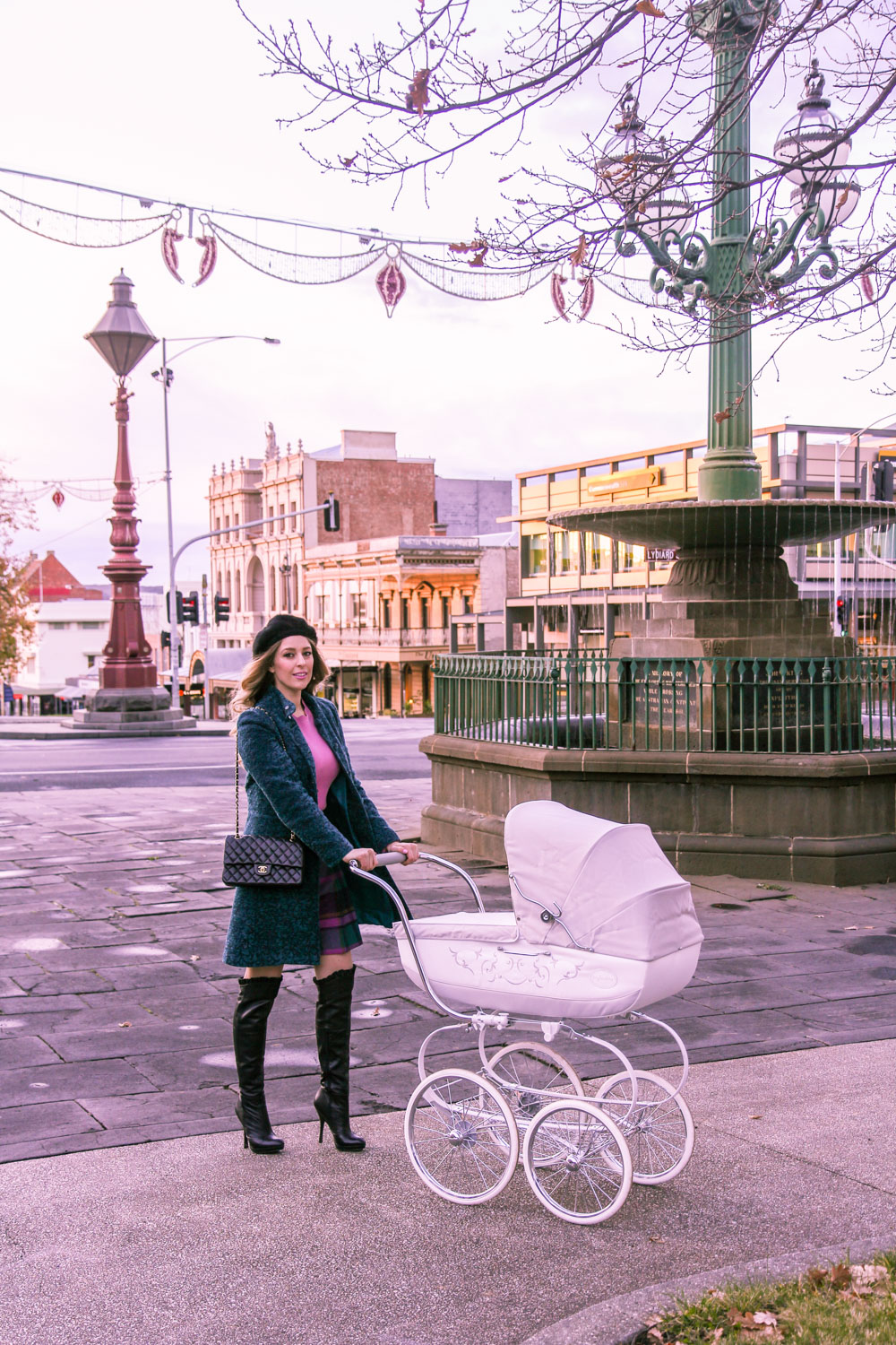 Goldfields Girl walking in Ballarat with vintage pram dressed in Alannah Hill top and skirt