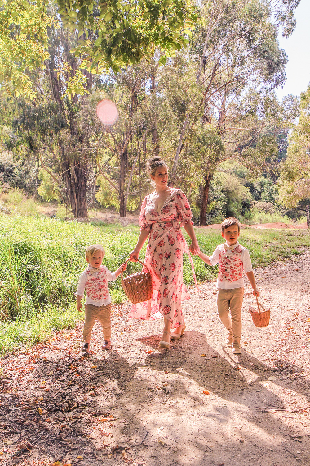 Goldfields Girl walking along forest trail with little boys all holding berry baskets